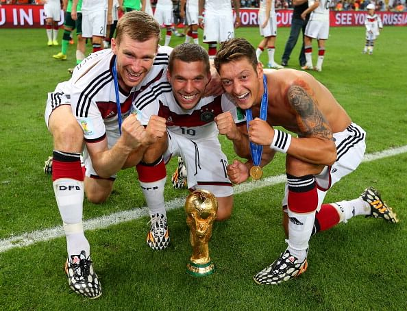 Mesut Ozil, Per Mertesacker and Lukas Podolski will miss start of Arsenal's season
