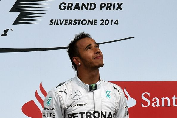 Hamilton takes popular home win at Silverstone as Rosberg retires