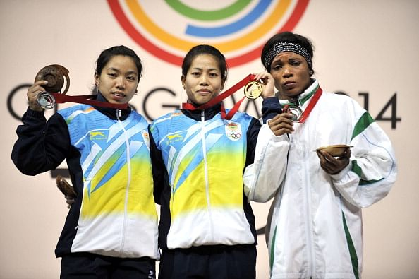 1st medals for India at CWG 2014: Sanjita wins gold, Mirabai silver in weightlifting