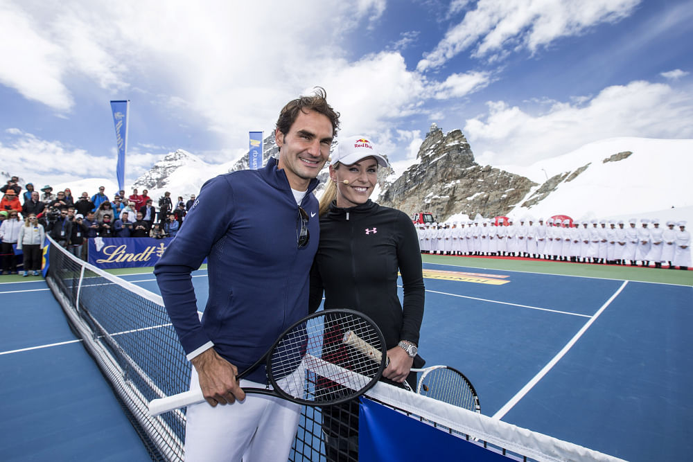 Roger Federer takes his tennis to new 'heights' as he faces Lindsey Vonn in an exhibition match