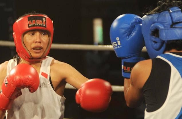 Commonwealth Games 2014: Sarita Devi reaches quarterfinals; Manoj Kumar, Sumit Sangwan ousted