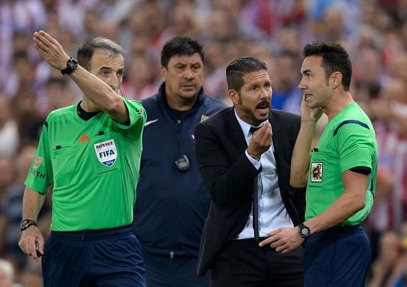 Atletico Madrid manager Diego Simeone banned for eight matches for sideline scuffle with assistant referee