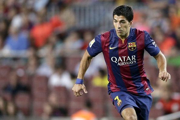 Barcelona striker Luis Suarez promises to never bite again
