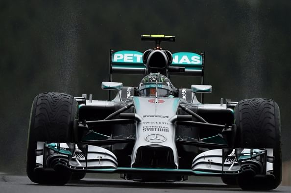 Rosberg beats Hamilton for pole amid wet conditions at Spa