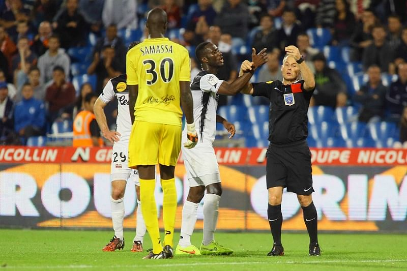 Ligue 1 player Benjamin Angoua blocks referee from sending off his teammate