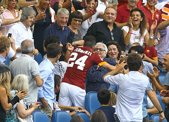 Roma midfielder Florenzi kisses his grandmother after scoring a goal
