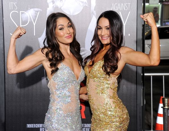 Reports: Bella Twins to lead teams in