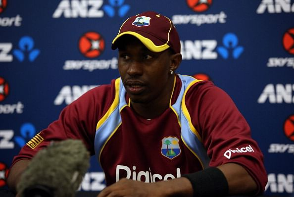 West Indian players stand behind captain Dwayne Bravo at toss before 4th ODI