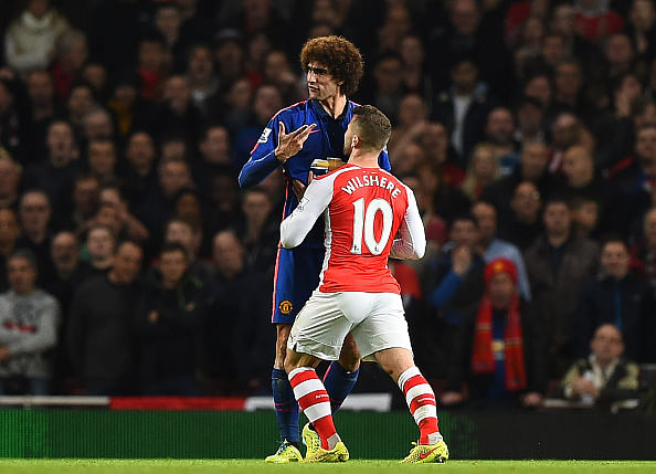 Video: Jack Wilshere lucky to escape punishment after appearing to head-butt Marouane Fellaini