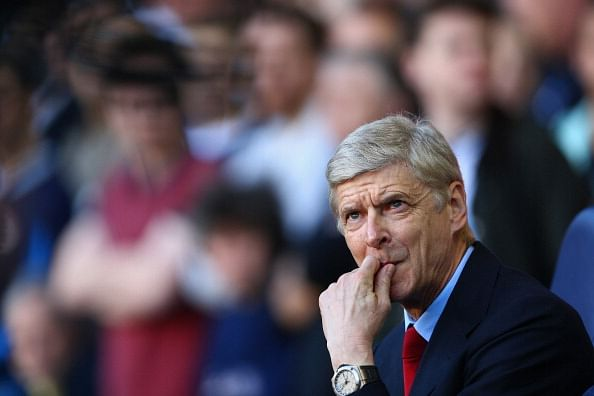Arsene Wenger hints title race is already over