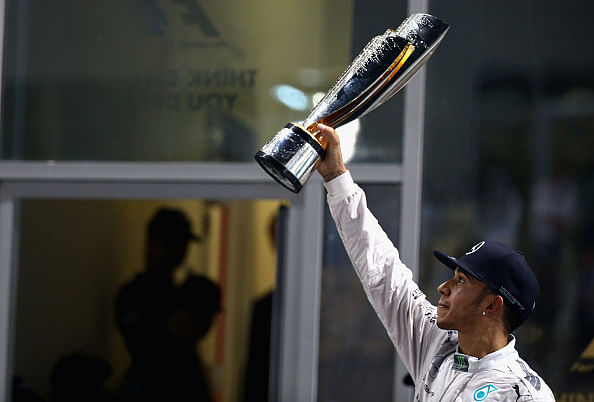 Hamilton wins Abu Dhabi Grand Prix, clinches 2014 Formula 1 drivers' title