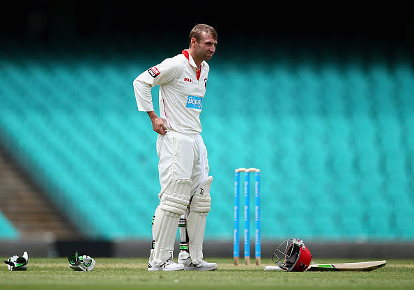 Phil Hughes collapses after getting hit by a bouncer