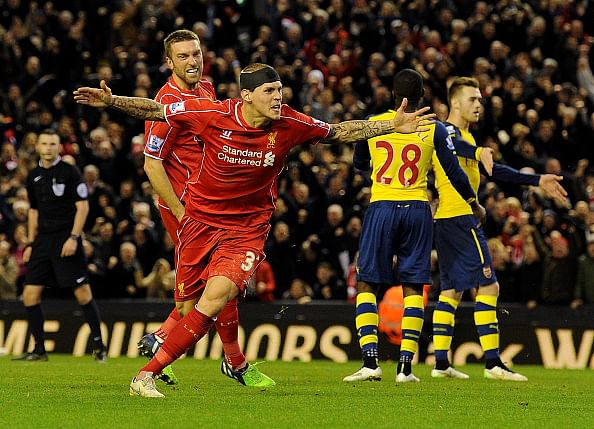 Highlights: 10-man Liverpool salvage a 2-2 draw against Arsenal at Anfield