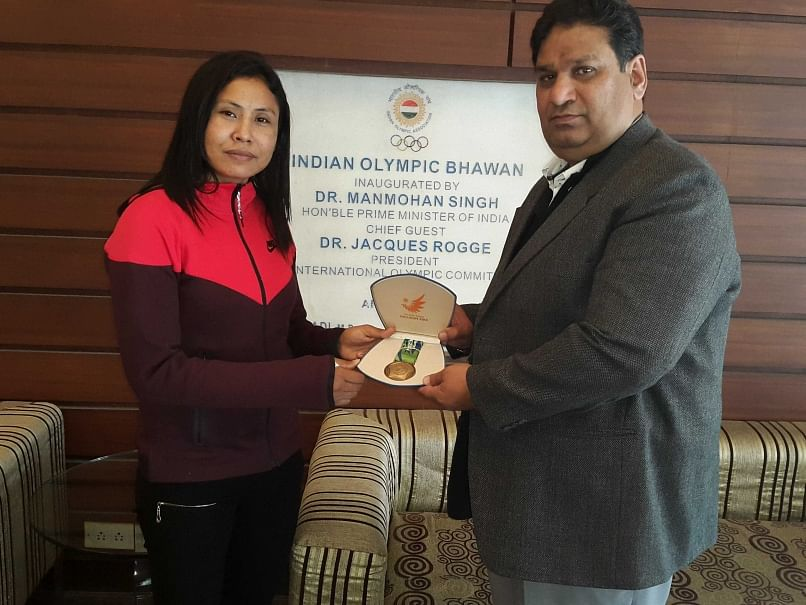 Sarita Devi accepts her Asiad Bronze medal