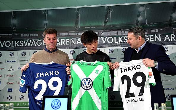 Wolfsburg sign midfielder Zhang Xizhe from Beijing Guoan FC