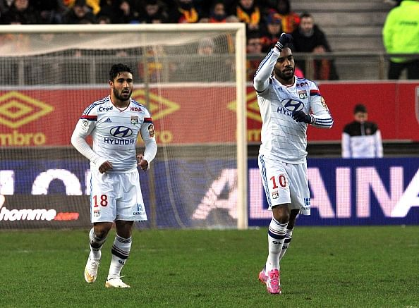 Lyon go four points clear on top of Ligue 1 with convincing win over RC Lens