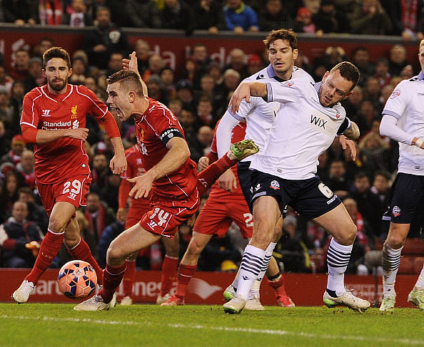 Bolton goalkeeper, Adam Bogdan, prevents Liverpool from scoring at Anfield in the FA Cup