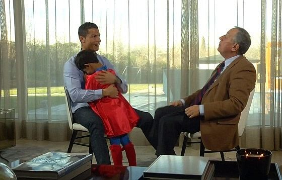 Video: Cristiano Ronaldo's son interrupts father's interview dressed as Superman