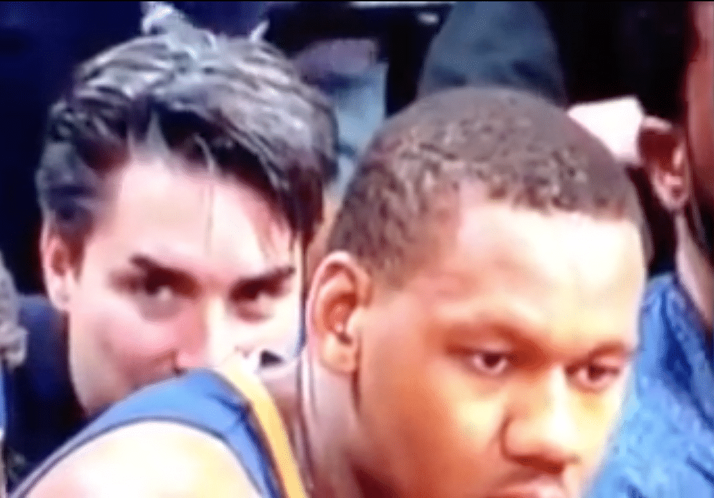 Basketball fan caught sniffing a player on camera