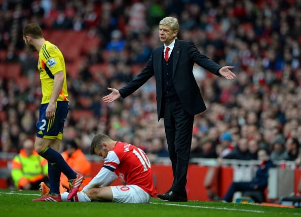 Arsene Wenger says Jack Wilshere will need to fight his way back into the Arsenal starting XI