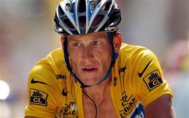 Cyclist Lance Armstrong charged with car crash