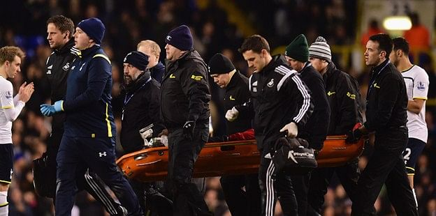 Swansea City's Bafetimbi Gomis hospitalised after fainting in match against Tottenham Hotspur