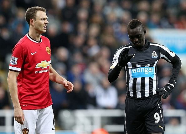 Newcastle United's Papiss Cisse apologizes for spitting incident; Manchester United's Jonny Evans maintains innocence