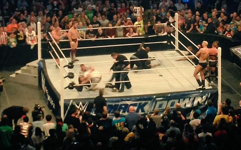 UK fans invade SmackDown ring and do Rock Bottom