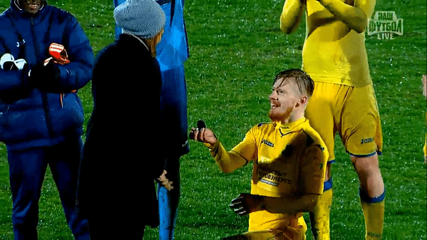 Video: Love is in the air! Russian footballer proposes to girlfriend on the pitch after full time