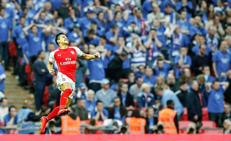 Alexis Sanchez and Mesut Özil excel in Arsenal's dispatch of Reading for FA Cup final spot