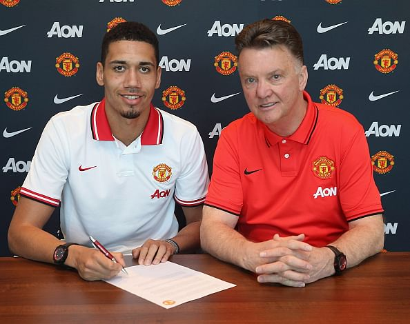 Smalling signs a new contract but his place is far from certain