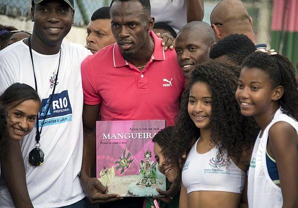 Usain Bolt continues Rio goodwill tour