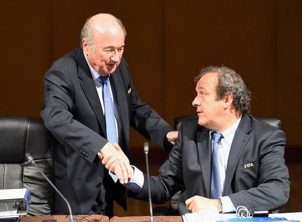 UEFA chief Michel Platini asks FIFA boss Sepp Blatter to step down
