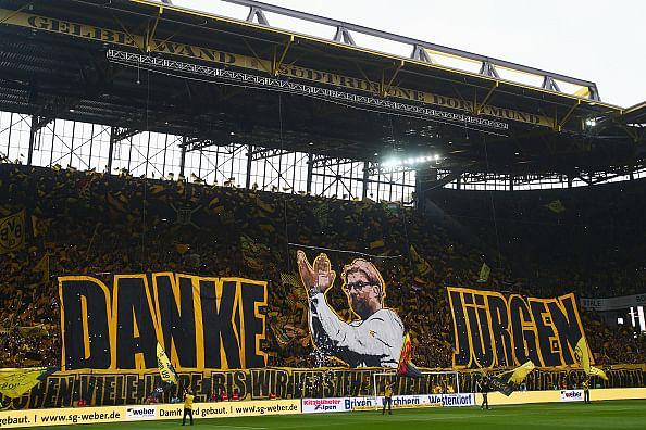 Dortmund Fans Fans of Dortmund Hold up a