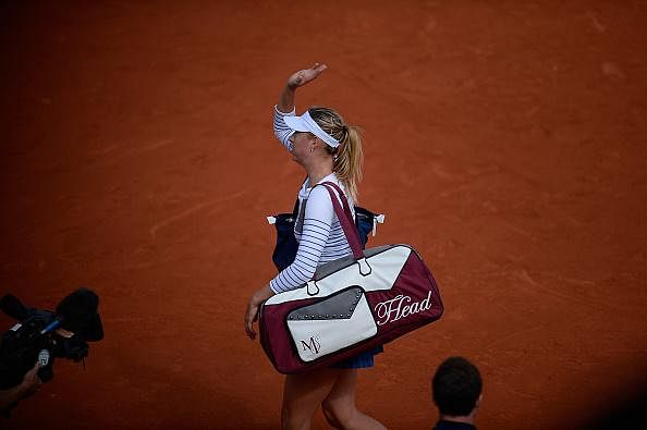 Maria Sharapova wins easily but booed by crowd