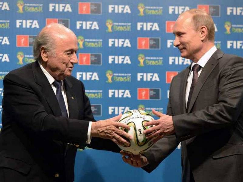 FIFA arrests bid to take 2018 World Cup away from Russia, says President Vladimir Putin