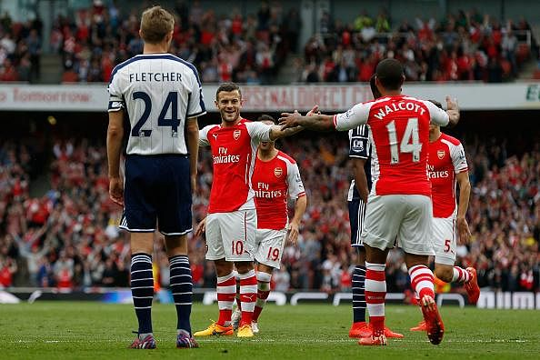 Theo Walcott and Jack Wilshere lay waste to the want-away rumours