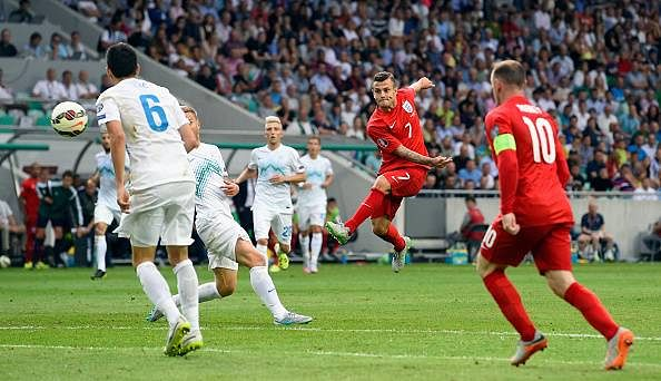 Highlights: Jack Wilshere and Wayne Rooney give England 3-2 win over Slovenia in Euro 2016 qualifier