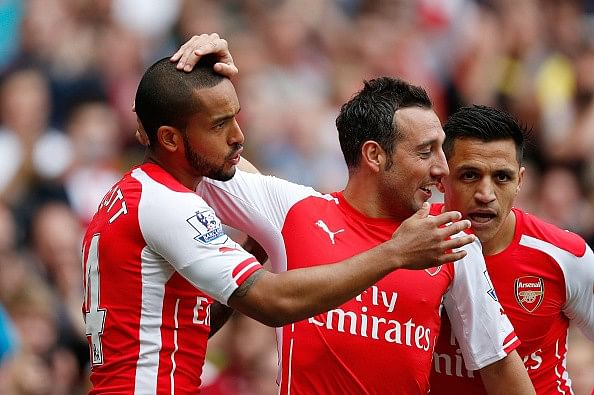 Theo Walcott and Santi Cazorla extend Arsenal contracts