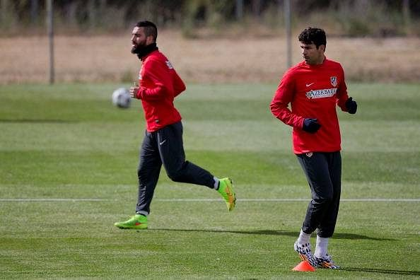 Diego Costa wants Atletico Madrid's Arda Turan at Chelsea