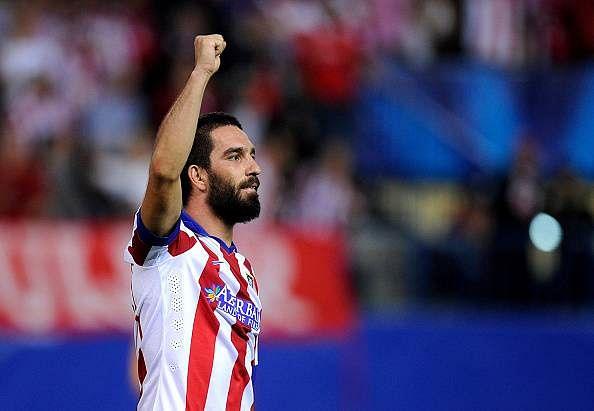 Report: Arsenal to offer Santi Cazorla plus cash for Atletico Madrid midfielder Arda Turan