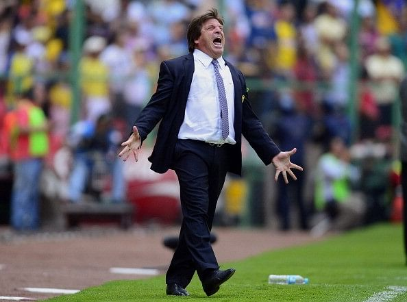 Mexico football coach Miguel Herrera sacked after allegedly punching a journalist