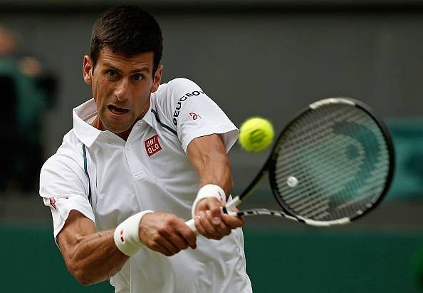Wimbledon 2015: Novak Djokovic cruises past Bernard Tomic to reach the fourth round