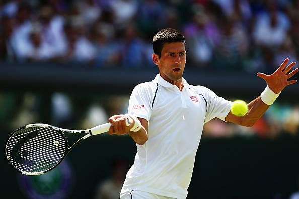 Novak Djokovic advances to third round with a straight sets win over Jarkko Nieminen