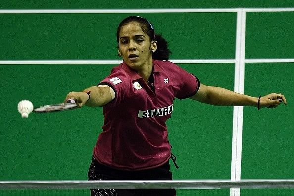 Saina Nehwal says she is trying to maintain her performance by giving 100 per cent from her side