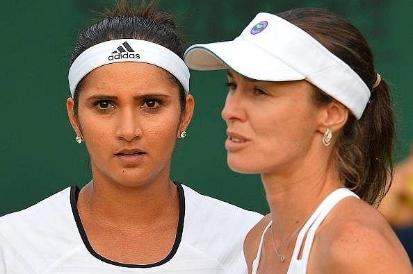 Sania Mirza - Martina Hingis cruise to third round at Wimbledon