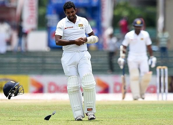 Best Pictures of the Day - Braveheart Dhammika Prasad, an inequal face-off and Pujara's unique feat