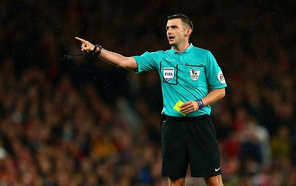 Michael Oliver replaces his wife as match official at half-time in women's match