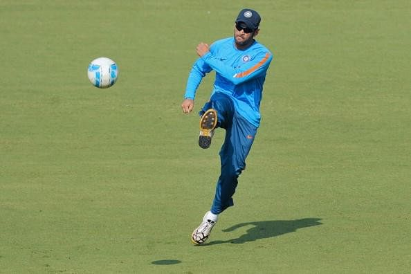 Dhoni plays football to test endurance ahead of grueling schedule