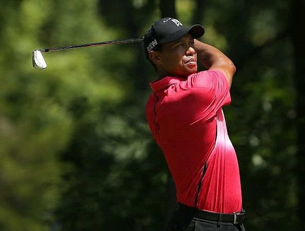 Video: Tiger Woods hits an incredible recovery shot at Quicken Loans National